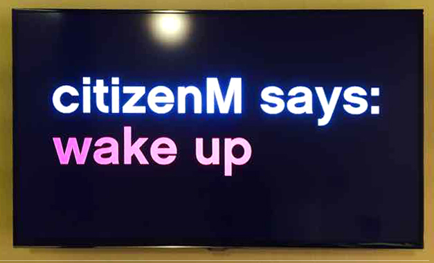 Citizen M says Wake Up, morning wake up message.