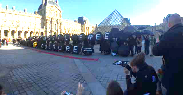 Fossil Free Action outside the Louvre Museum in Paris